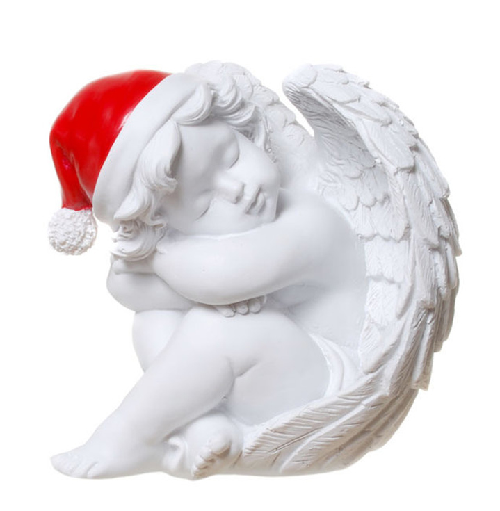 träumender weihnachtsengel mit roter mütze